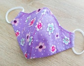 Protective mask in cotton fabric, 2 layers, elastic aves. Size flower pattern on purple background