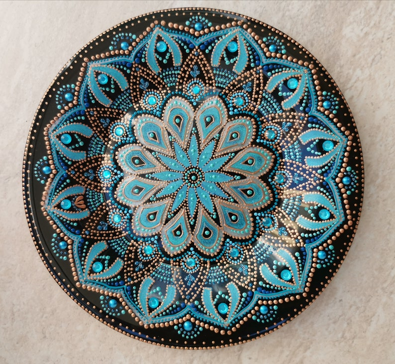 Turquoise decorative plate on a stand. Hand-painted in the ...