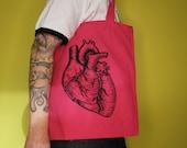 Anatomical heart handprinted on pink cotton bag with long handles, design: anatomical heart, black, linocut printing