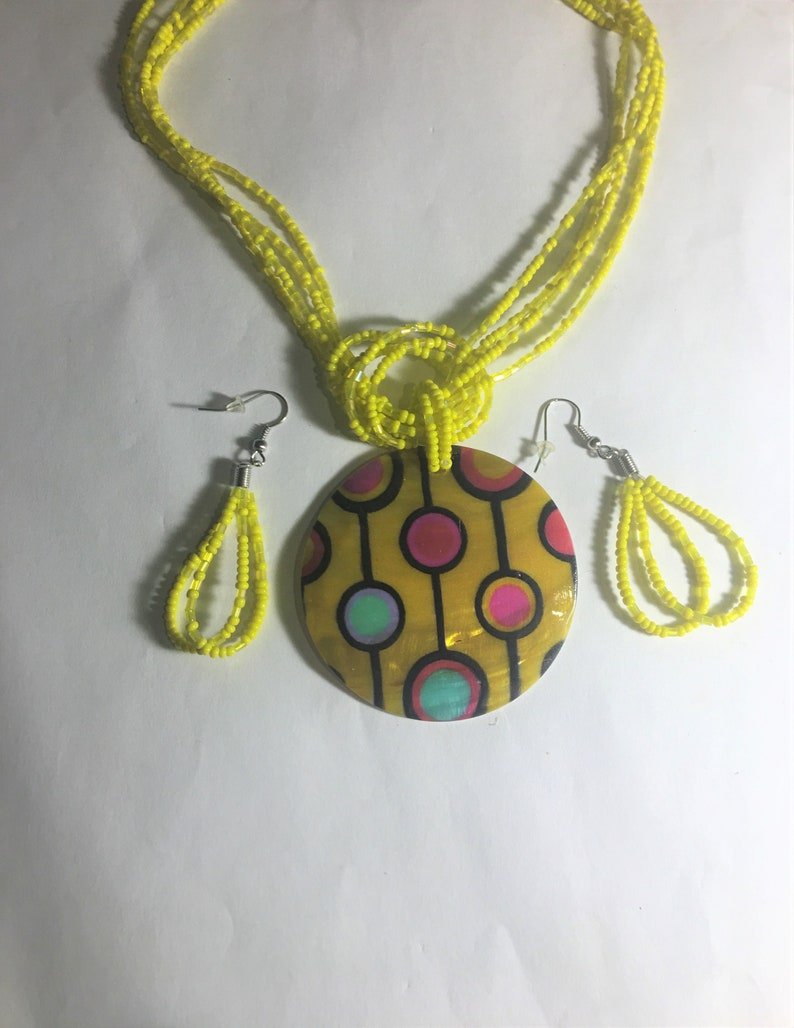Yellow Shell  Disc Reflections Pendant with Multi Color Design Beaded Multi Strand Necklace and earrings Set