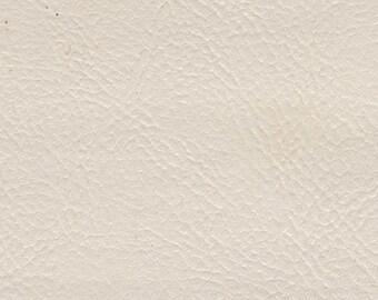 BTY Vintage Cotton White Auto Vinyl w/ Fine Grain