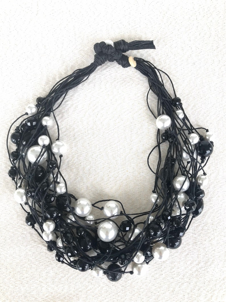 Black waxed cotton multi-row neckline white resin pearls and black crystals