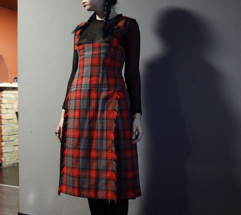 Vintage red tartan check dungaree dress with pleated skirt and fringe