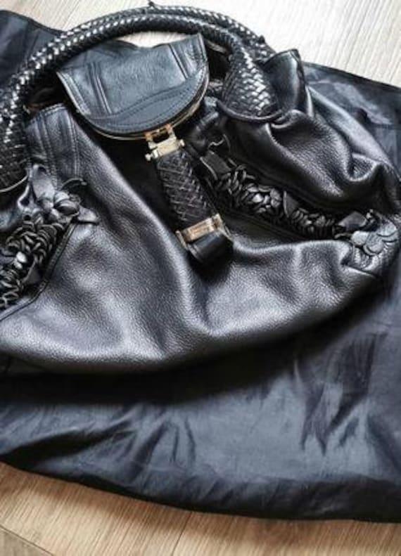 Vintage rare leather designer handbag