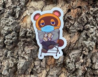 "Animal Crossing: Tom ""Bernie"" Nook Inauguration Style with Mask 2.03"" x 3"" Die-Cut Sticker"
