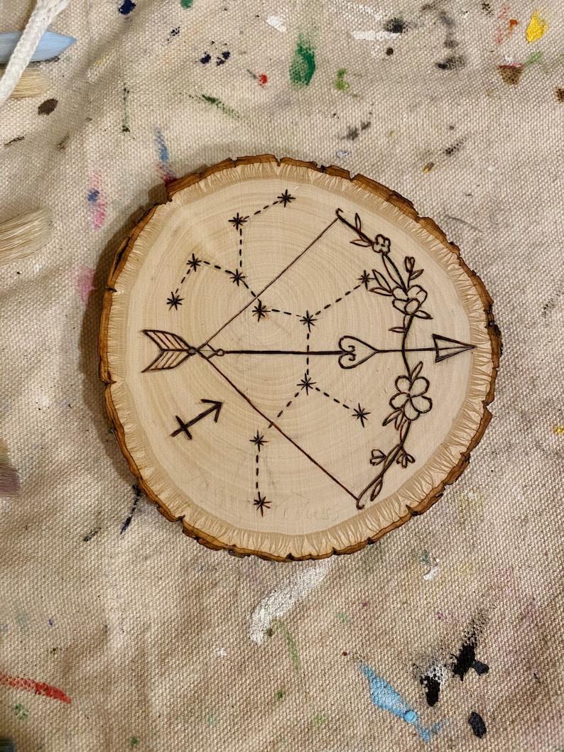 Sagittarius wood burning
