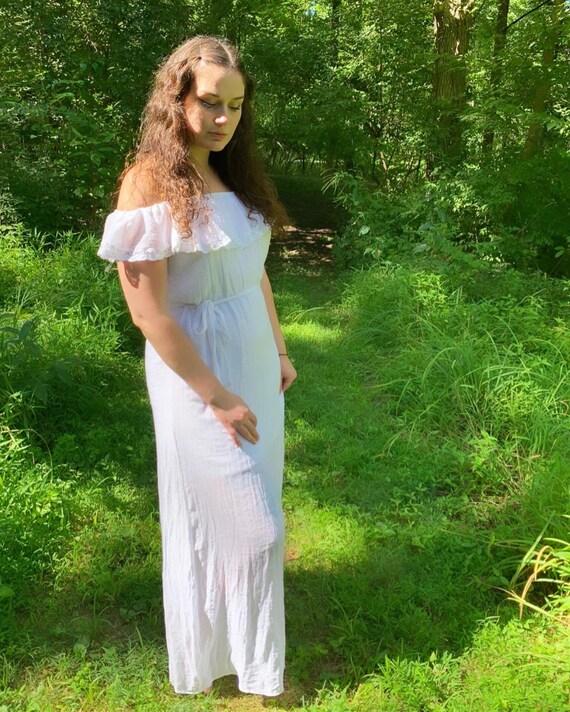 Off-shoulder white maxi dress