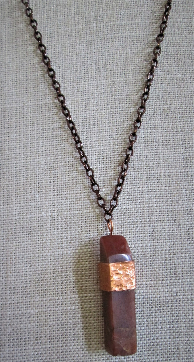 red onyx stone pendent with copper