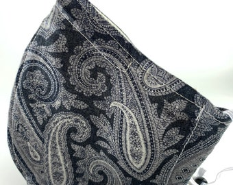 Best fitting washable face mask with filter pocket, nose wire and adjustable ear loops. Soft, breathable lining. Black paisley. SHIPS NOW