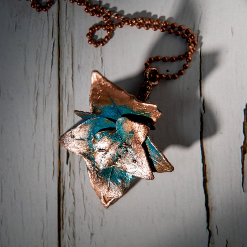 jewelry necklace on the neck,branch of ivy, Copper jewelry pendant ivy leaf with a turquoise patina for a gift to a woman