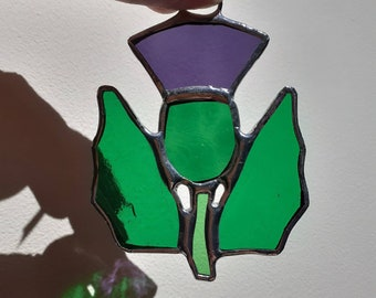Stained glass little thistle suncatcher hanging glass Scottish flower art tourist gift handcrafted in Scotland at Harestanes Glass Studio