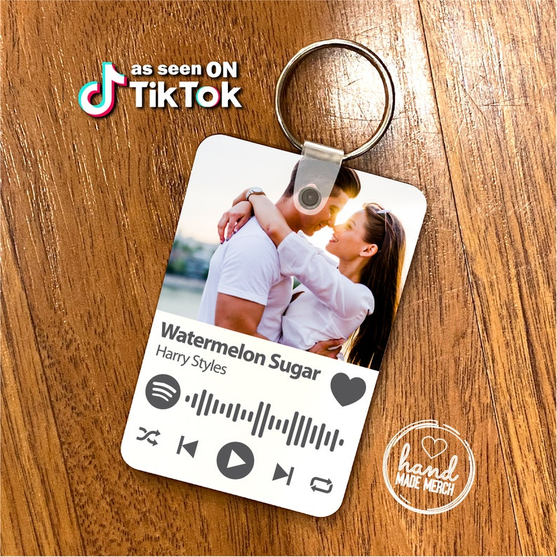 This custom keychain is made of wood and has your favorite album or playlist included. You can customize whatever you like by picking up album covers or personal photos. This cute photo keychain is quite cheap and suitable for couples. Customize yours to bring your love along to everywhere you go!