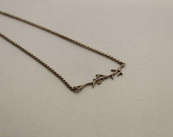 Silver handmade necklace with twig