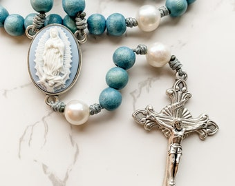 Catholic rosary with cameo Our Lady of Guadalupe centerpiece, blue wood beads, pearl beads, and micro cord | Catholic gift