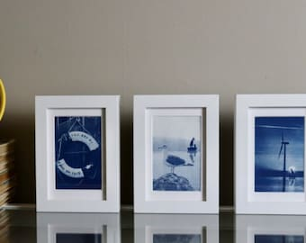 Cyanotype Buoy | nautical wall art | sunprint photography of buoy negative with added text | shades of blue on watercolor paper |
