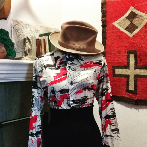 70s does 30s bullfighter print shirt.
