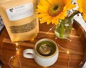Positive Energy mood boosting tea with St. Johns Wort, lemon balm, lavender, sage, safflower, and lemon.