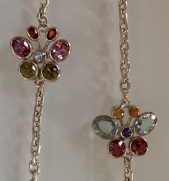 silver necklace and gemstones