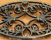 Oval Ornate Cast Iron Trivet