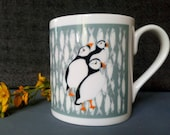 Puffins Design, Fine Bone China Mug. Design from original artwork. Comes as a Boxed Gift, gift options available.  Printed in the UK