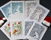 Christmas Cards Multi Pack of 8.  Fine art cards hand embossed. Wrapped in a biodegradable Sleeve. Blank inside . Made UK