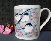 Long -Tailed Tits Design, Fine Bone China Mug. Design from original artwork .Comes as a boxed Gift, gift option available. Printed in UK.