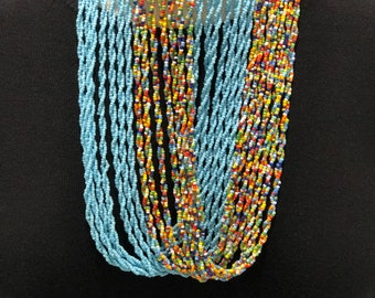 String bead necklace, light blue and multicoloured bead strings. Ring type necklace. Tribal Jewellery - African Jewellery.