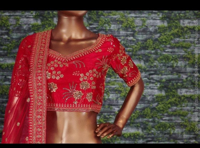 party wear designs Sabyasachi designer lehnga embroidered with beautiful design Artistic design
