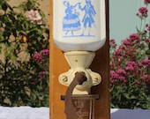 Old-housed manual coffee grinder, ceramic and glass, wooden structure
