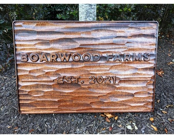Carved Mahogany Sign with Textured Background