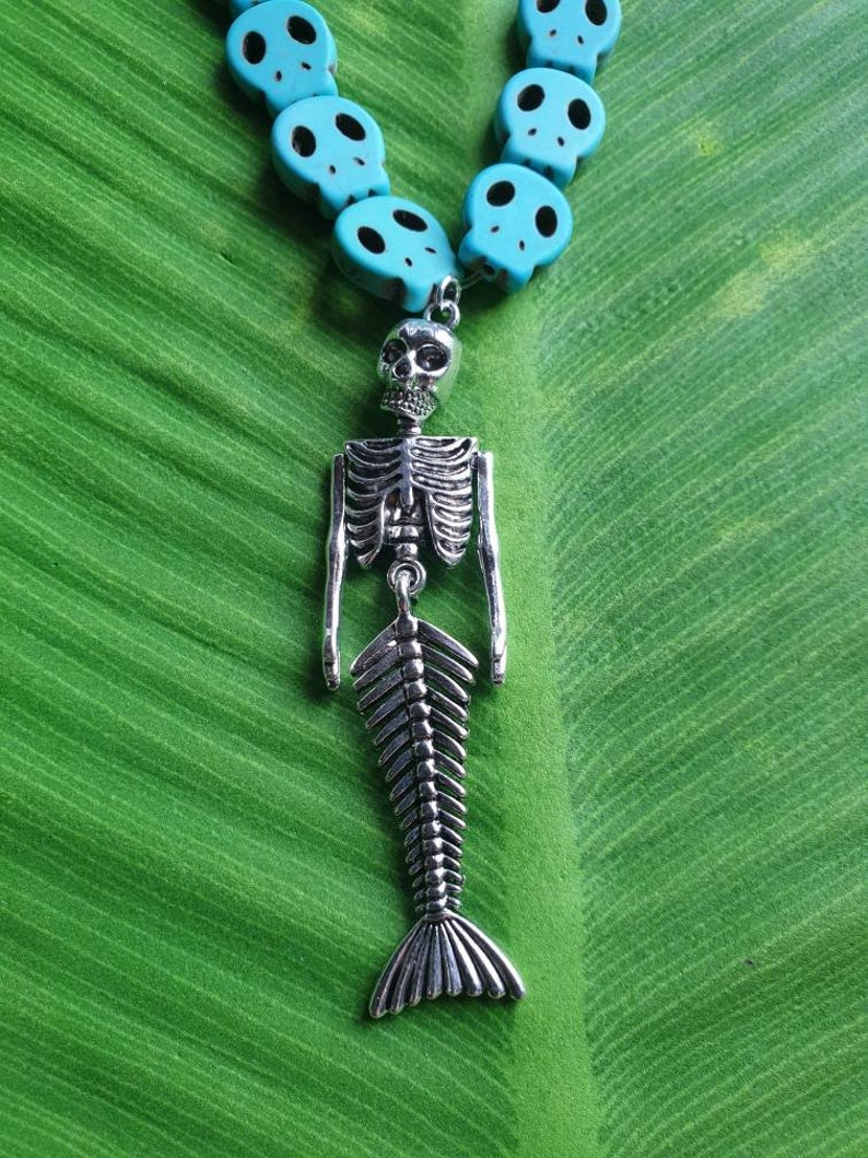 Punk necklace with mermaid skeleton tropical tiki beaded skulls of various white and turquoise colors pinup exotic