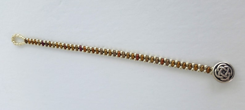 Gold Rainbow Hand Beaded Bracelet With Irish Knot Button Closure And Silver Seed Bead Accents