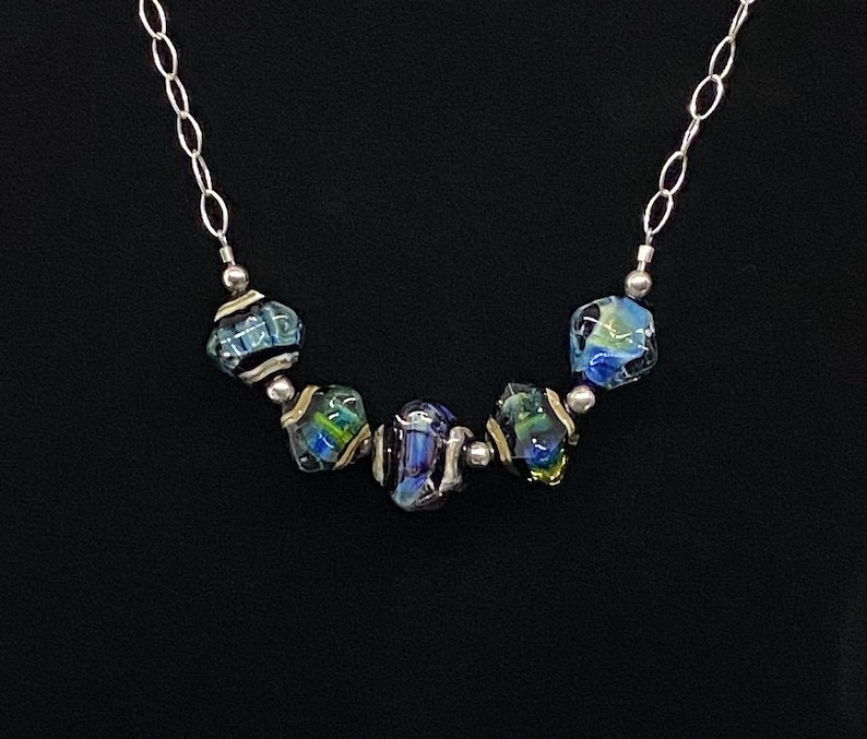 Handmade glass and sterling  silver necklace with changeable colors of sky blue and emerald green