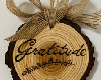 """Stunning Gratitude Round wall hanging, 3.5"""" x 3.5"""", Engraved, Wood Burnt, Natural Wood with Tree Bark with Jute bow, Customization possible."""