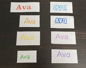 A set of 8 rainbow name stickers