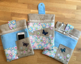 Butterfly and flowers padded ipad/tablet sleeve with zipped pocket, fits iPads and devices up to 26 cm x 20cm.