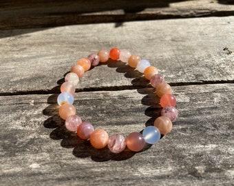 Heart of the Sun Reiki-Blessed Bracelet: Botswana Agate, Strawberry Quartz, Sunstone, Blue Chalcedony