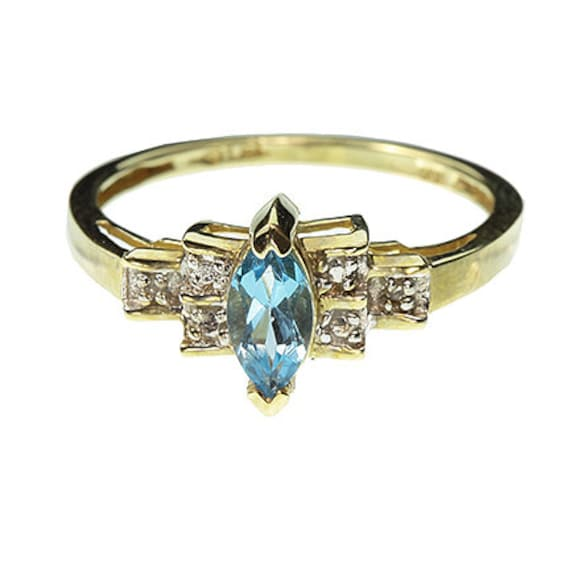 London Blue Topaz (0.65 cts) and Diamond Ring in 10kt Yellow Gold / Size: Ladies 6.5
