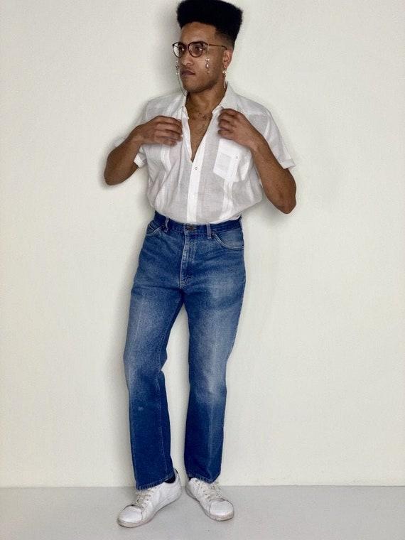 Distressed Lee Jeans 1980s