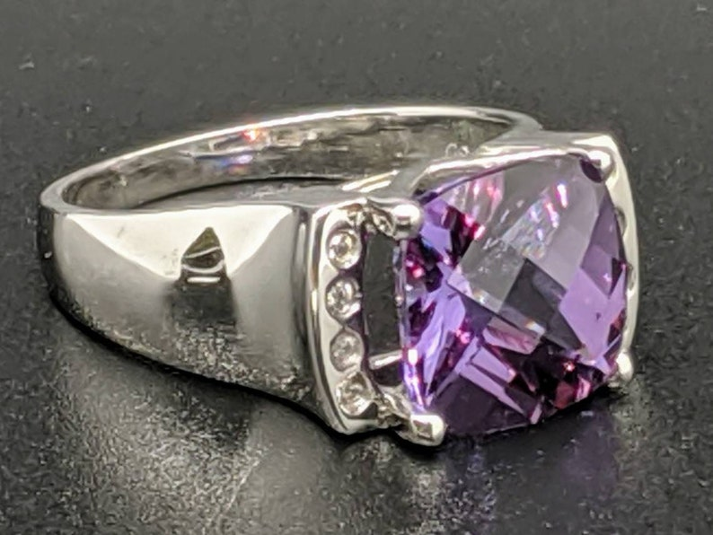 Size 7.25 US set in Sterling Silver with .12 CT Cubic Zirconia Accents 5.40 CT Alexandrite Ring