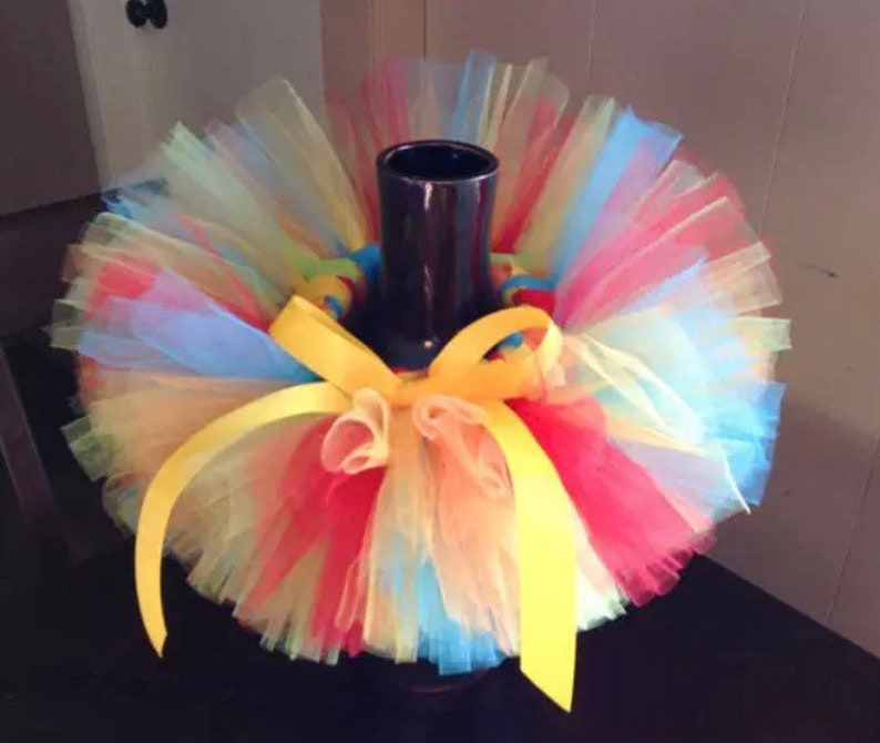 blue and yellow tutu Red