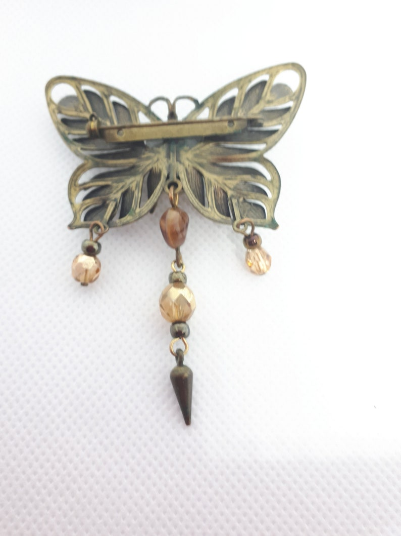 2 dimentional wings Butterfly brooch with drop beads center cabochon bead