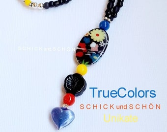 Cheerful, colorful necklace made of Bohemian glass with antique flower pearl and heart pendant.