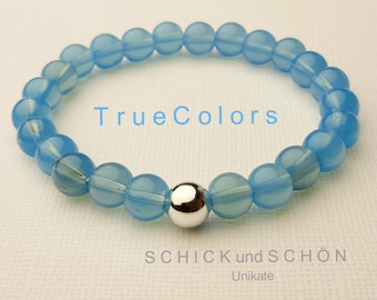 Bracelet in light blue jade and silver-plated spacer ball.