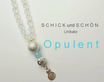 Long necklace of opalescent Bohemian glass beads with silver plated pendant and Amazonite beads.