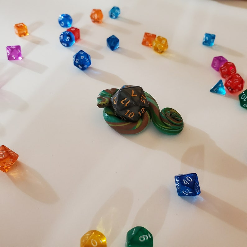 swirly snake dice holder and tabletop gaming friend. Snake  Companion dungeons and dragons dice holding familiar Tabletop Familiar