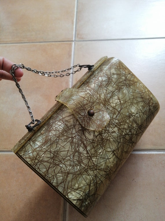 Gold and green lucite handbag