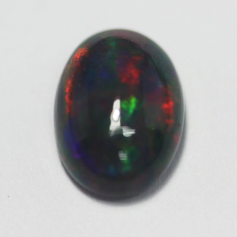 Excellent 1.20Ct Multi Flash Color Ethiopian Mine Opal Cab