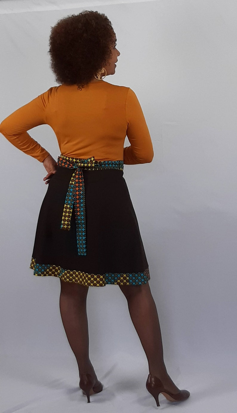 A stunning short length  full flare cotton wrap skirt with an ethnic trim