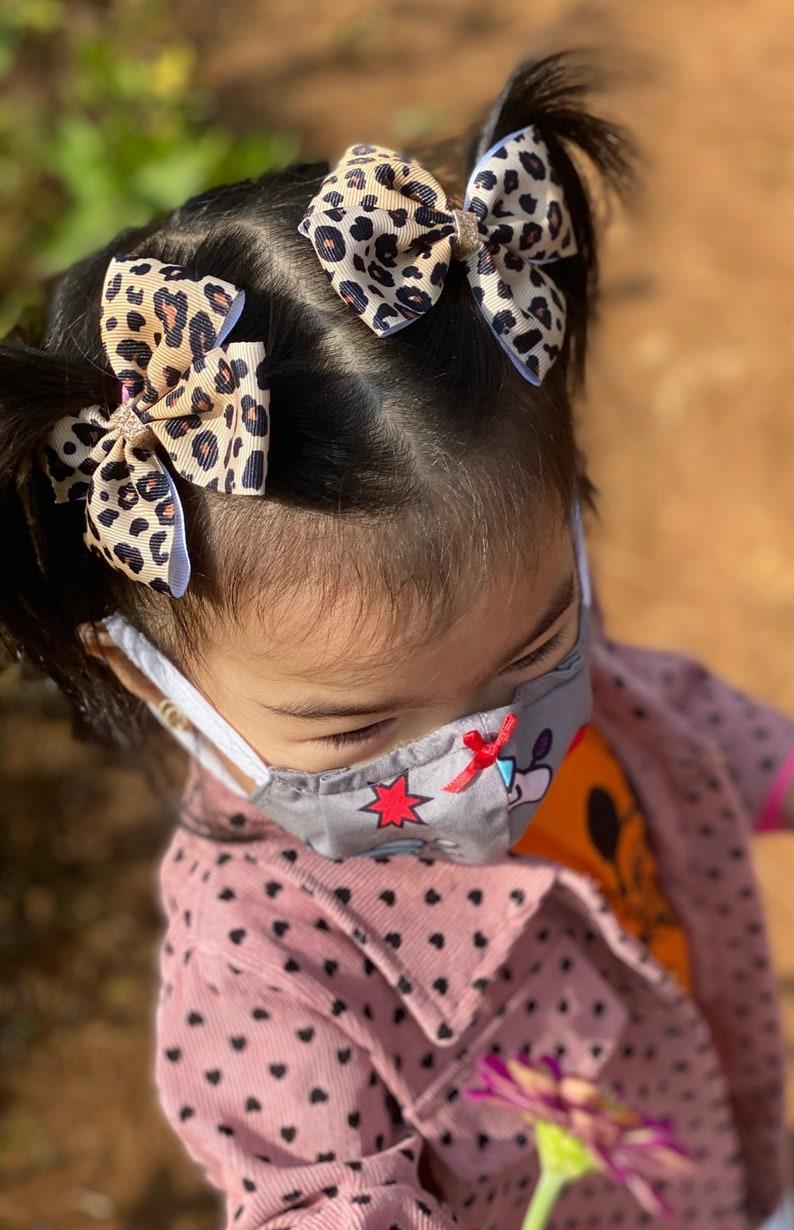 Set of 2 piggies hair bow cheetah print Leopard print hair bow clips. Cheetah print bow baby headband